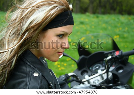 Teen girl on motorbike