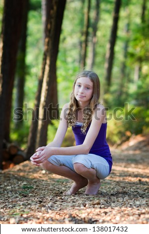teen girl out in the forest on a sunny summer day - stock photo