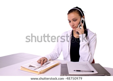 Teen Girl Paying Bills and Making a To Do List - Isolated - stock photo