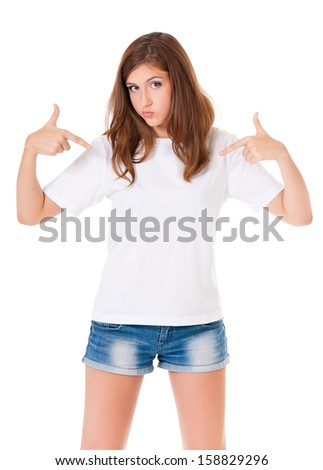 Teen girl pointing at blank white t-shirt isolated on white background - stock photo