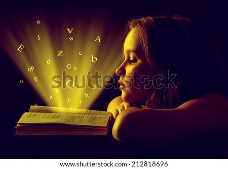 Teen girl reading the Book. Education - stock photo