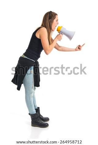 Teen girl shouting by megaphone   - stock photo