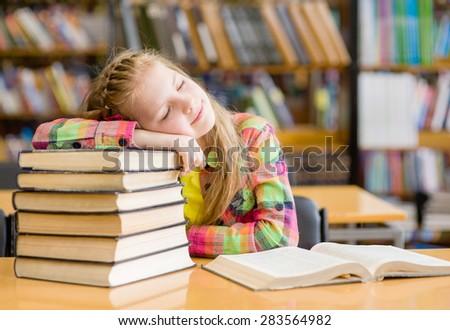 Teen girl sleep in library - stock photo