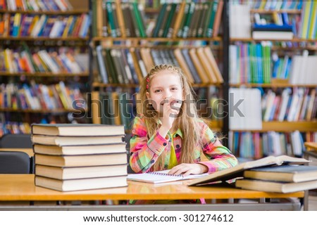 Teen girl studying at library - stock photo