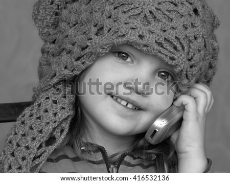 Teen girl talking on the phone black and white - stock photo