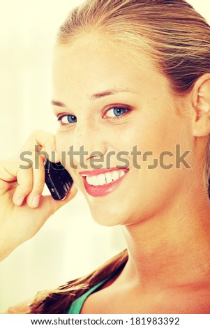 Teen girl using cell phone. - stock photo