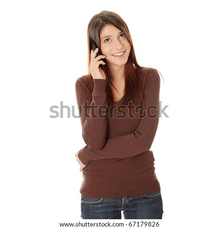 Teen girl using cell phone, isolated on white - stock photo