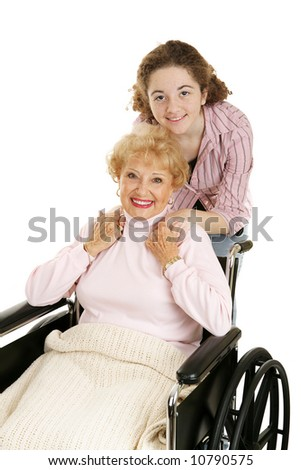 Teen girl with her disabled grandmother.  Isolated on white. - stock photo