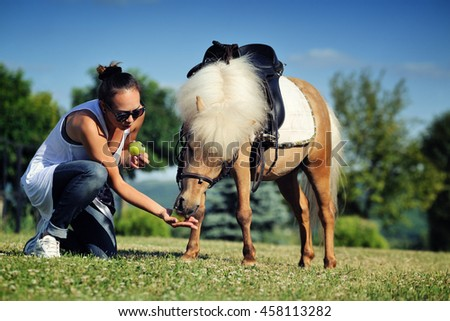Teen girl with palomino pony