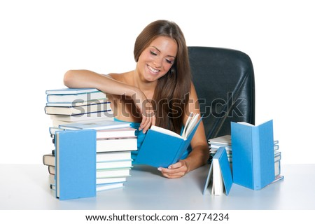 teen girl with pile of books reading and learning - stock photo