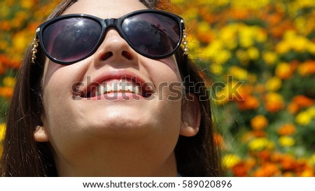 Teen Girl With Sunglasses And Flowers