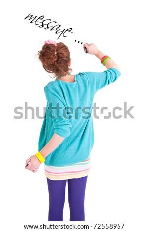 Teen girl write on the white wall - stock photo
