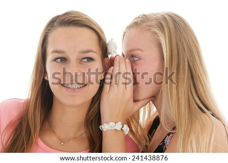 Teen girls are whispering gossip with good news - stock photo