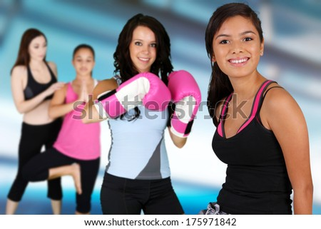 Teen girls working out in the gym - stock photo