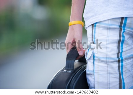 Teen holding a bag. - stock photo