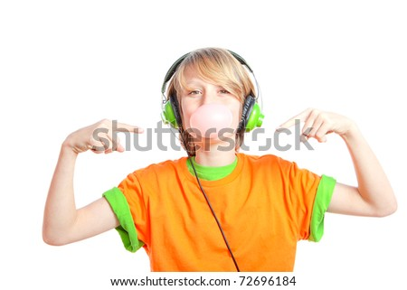 teen kid pointing to bubble gum listening to music with  ear phones