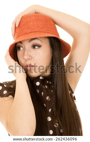 Teen model wearing orange hat looking away - stock photo