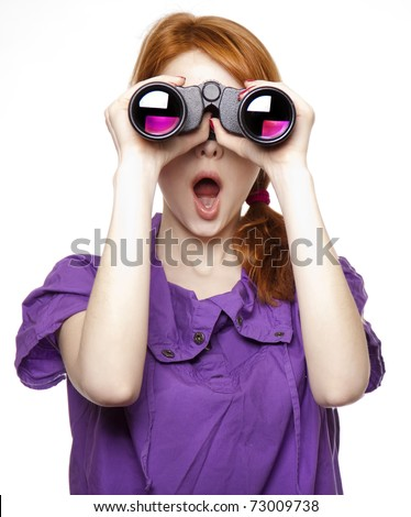 Teen red-haired girl with binoculars isolated on white background - stock photo