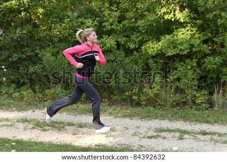 Teen running outside on a trail