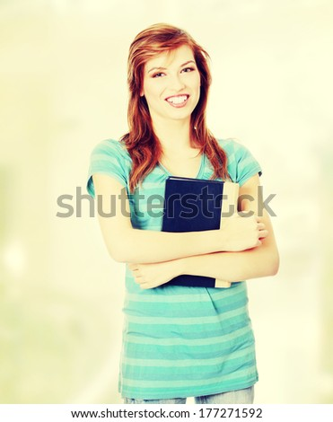 Teen student girl with a book - stock photo
