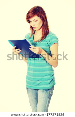 Teen student girl with notepad isolated on white background