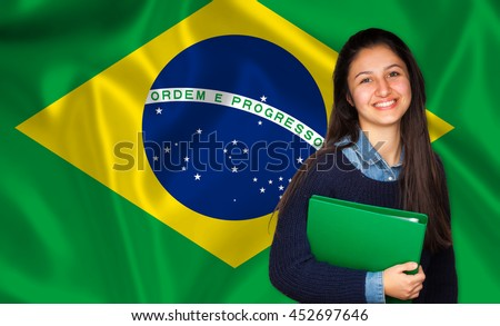 Teen student smiling over brazilian flag. Concept of lessons and learning of foreign languages.