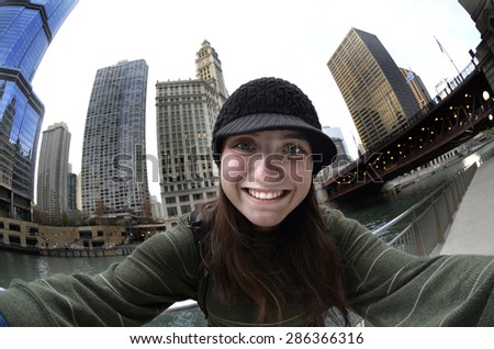 Teen teenager tourist girl taking selfie with camera in Chicago  - stock photo