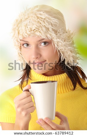 Teen winter girl with cup of hot drink (tea,coffee or milk) - stock photo