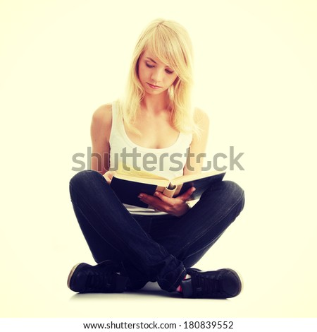Teen woman reading book  - stock photo