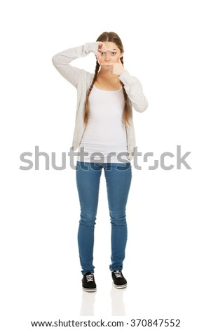 Teen woman with frame gesture. - stock photo