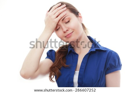 Teen woman with headache holding her hand to the head - stock photo