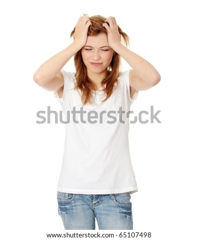 Teen woman with headache holding her hand to the head, isolated on white - stock photo