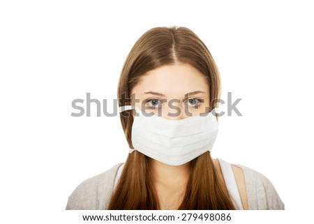 Teen woman with protective face mask. - stock photo
