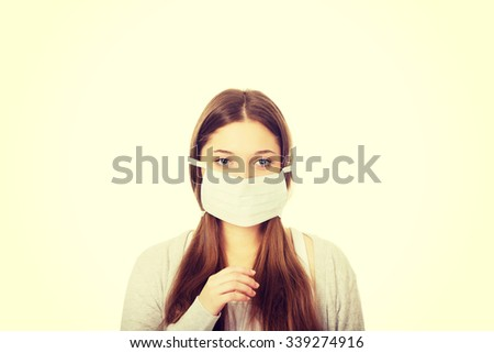Teen woman with protective face mask.