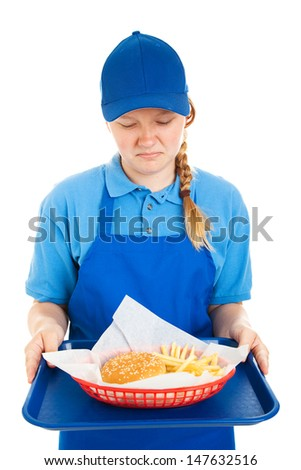Teen worker disgusted by fast food meal.  Isolated on white.   - stock photo