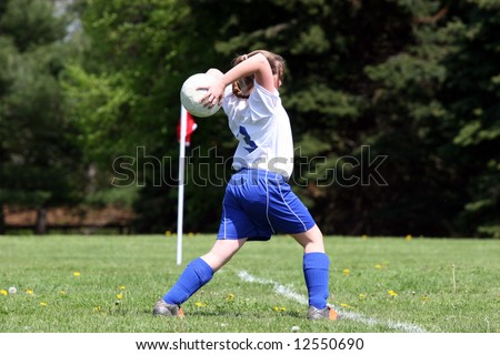 Teen Youth Soccer Player in Action on Field 2 - stock photo