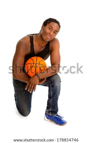 Teenage African American Boy with Basketball  - stock photo