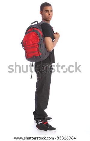 Teenage African American student wearing jeans and t-shirt, standing with school backpack. - stock photo
