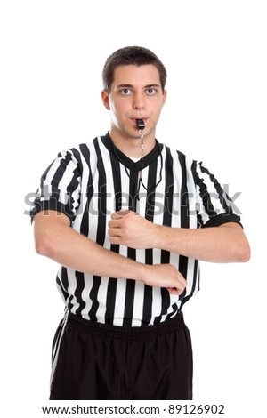 Teenage basketball referee giving sign for traveling - stock photo