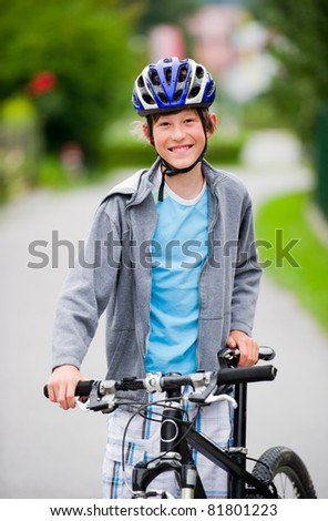 Teenage boy cycling and hanging out in a suburban setting. - stock photo