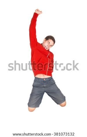 Teenage boy  doing funny acrobatic jumps isolated in white