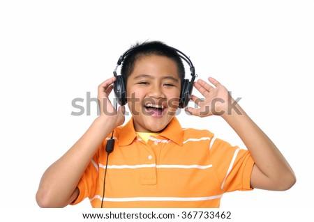 Teenage boy listening to music  - stock photo