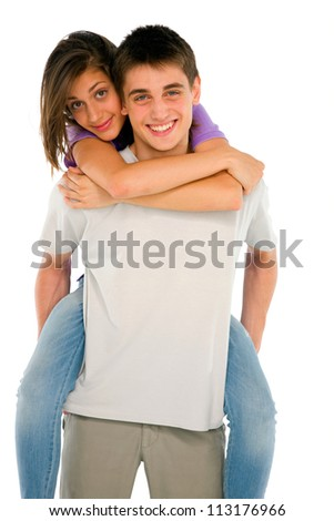teenage boy piggybacking teenage girl - stock photo