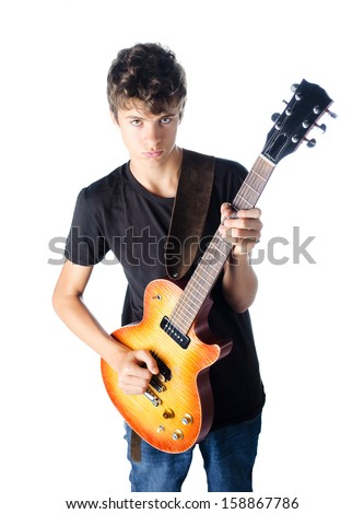 Teenage boy playing guitar isolated on white, serious and cool expression
