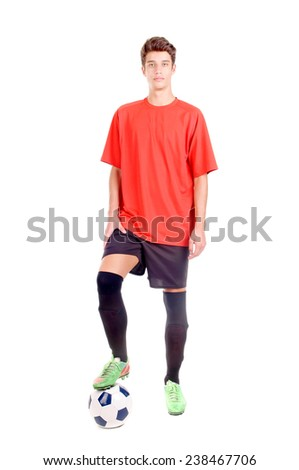 teenage boy playing soccer isolated in white - stock photo