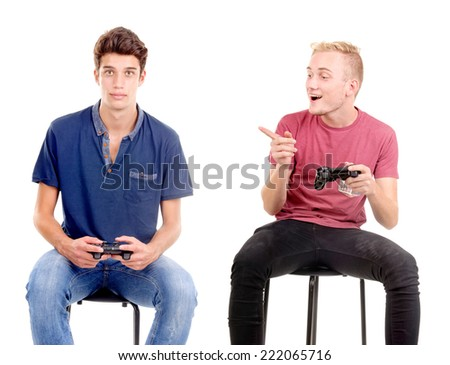teenage boy playing videogames isolated in white - stock photo