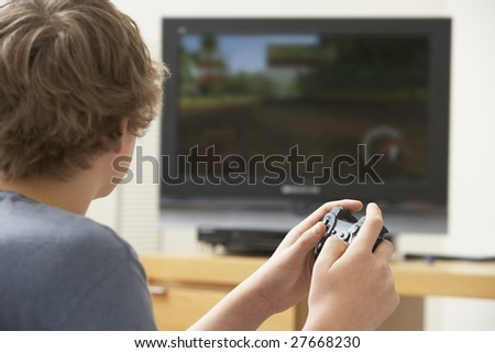 Teenage Boy Playing With Game Console - stock photo
