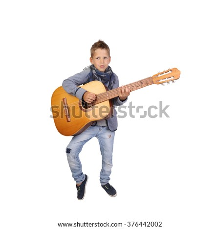 Teenage boy plays a big guitar isolated on white background in square - stock photo