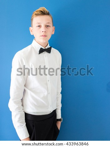 Teenage boy portrait on colorful background wall