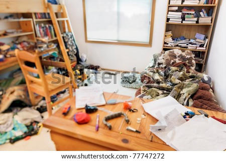 Teenage boy's messy room. Tilt shift lens, with focus on pillow & comforter - stock photo